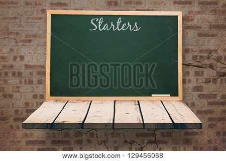 Starters message against blackboard on a wooden shelf