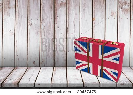 Great Britain flag suitcase against wooden table