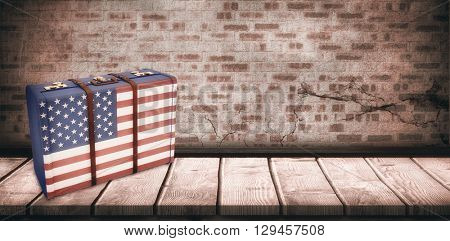 USA flag suitcase against wooden board