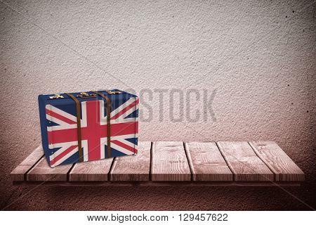 Great Britain flag suitcase against wooden shelf