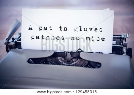 The sentence a cat in gloves catches no mice against white background against a paper in a printer