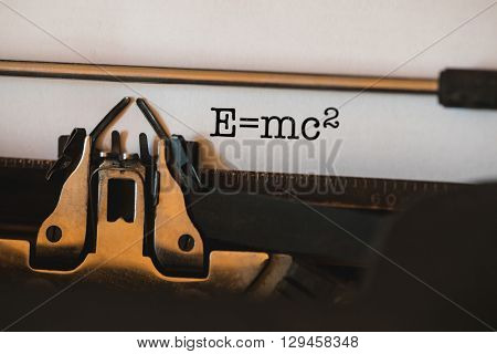 The word e=mc2 against close-up of typewriter