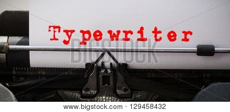 The word typewriter against white background against close-up of typewriter