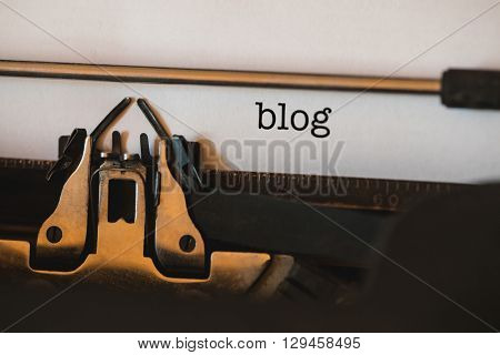 The word blog against close-up of typewriter