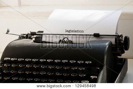 The word legislation against typewriter on a table