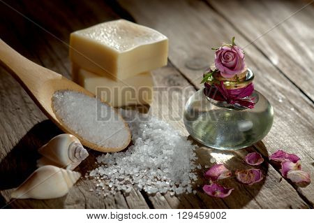 Spa still life with bath salt and soap on wooden ground