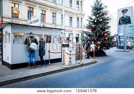 BERLIN, 4 December: Checkpoint Charlie. Former bordercross in Berlin on 4 December, 2014. Berlin Wall crossing point between East and West Berlin during the Cold War. BERLIN, GERMANY