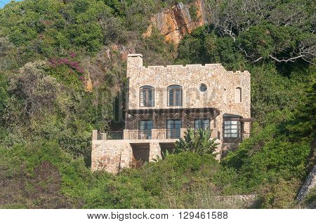 A house on the slopes of a hill in Noetsie. Noetsie is a popular tourist attraction due to the houses that were built to look like castles.
