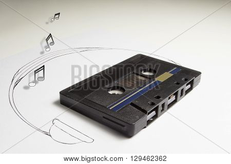 Audiotape and headphone draw on white background