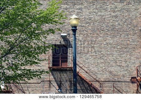 A lamppost stands outside the back of the Rialto Square Theatre in downtown Joliet, Illinois.