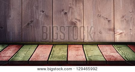 Red and khaki parquet against wooden background