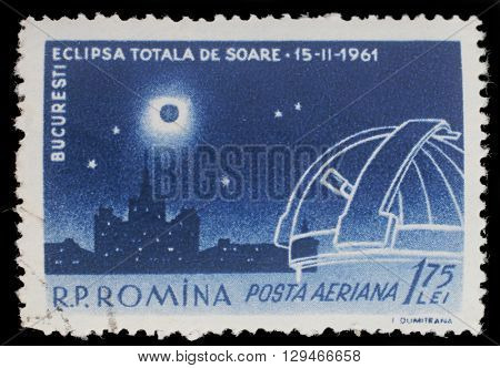 ZAGREB, CROATIA - JULY 19: stamp printed in Romania shows Total Eclipse over Scanteia Building and Observatory, with inscription Bucharest, Solar Eclipse, circa 1961, on July19, 2014, Zagreb, Croatia