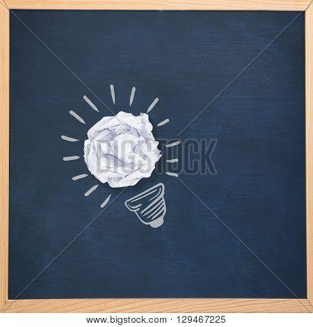 Light bulb against image of ac chalkboard