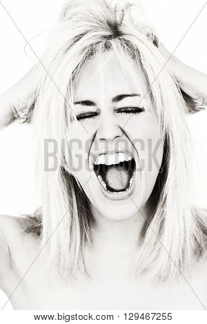 Black and white studio photograph of a beautiful young woman screaming and shouting loudly.