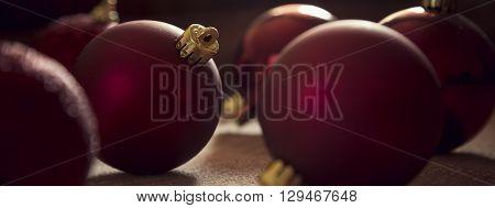 Multiple shiny red Christmas tree decoration balls