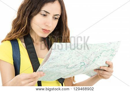 Tourist woman reading a travel map with a confused look. Isoalted on white background.