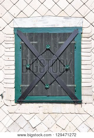 Colorful and crisp image of traditional shutter in bavarian forest