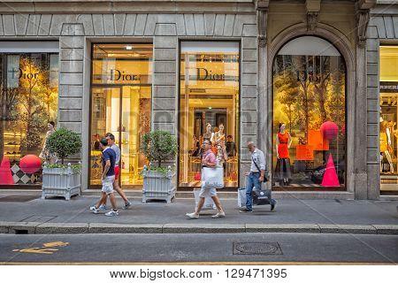 Milan, Italy - Circa August 2013: People walking near fashion Dior stores in Milan.