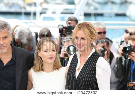 CANNES, FRANCE - MAY 12: Jack O'Connell, George Clooney, Jodie Foster and Julia Roberts, 'Money Monster' Photocall, 69th Cannes Film Festival at Palais des Festivals on May 12, 2016 in Cannes, France.