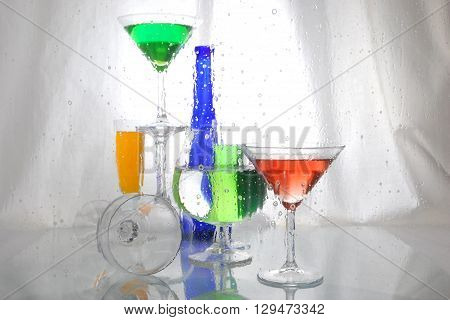 still life of wine bottle and stemware with reflection