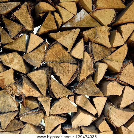 Background Of Many Logs And Timbers In Woodpile