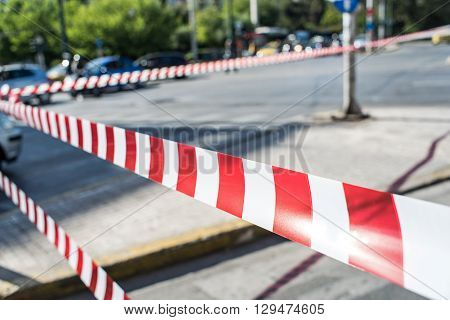 Red and white striped security tape of police