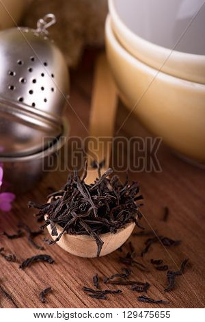 Heap Of Dry Tea Placed On Wooden Spoon