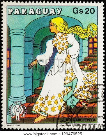 MOSCOW RUSSIA - MAY 11 2016: A stamp printed in Paraguay shows Cinderella in palace - scene from a fairy tale series