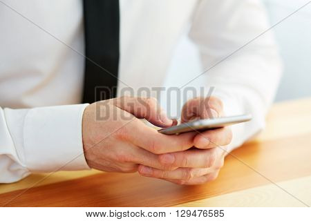 Male Hands Holding A Cell Phone And Writing