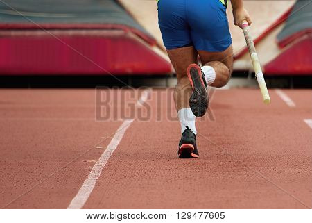 Pole vaulter taking off for a jump