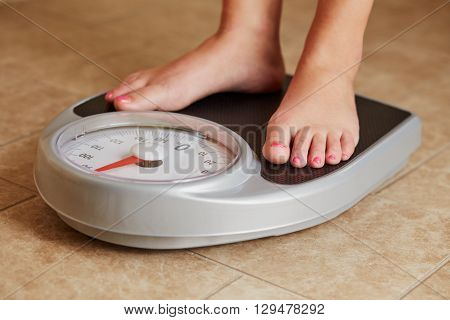 Female Bare Feet On Weight Scale In Bathroom