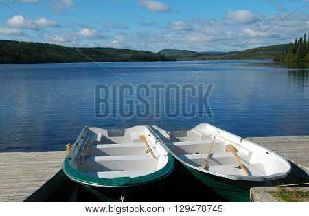 Picture of 2 row boats on St-Anne Lake in National Park of Grands-jardins, Quebec, Canada.