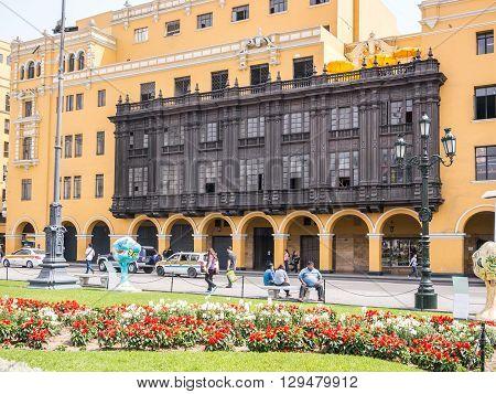 Lima, Peru - October 11 2014 - Spanish colonial era facades in Lima Plaza de Armas (Main Square)