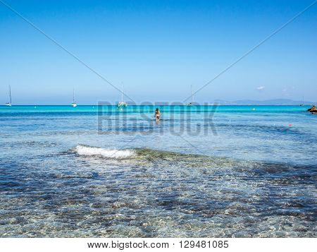 A girl walking into the Blue, Cala Saona