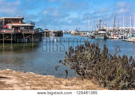 Monterey,California,USA - July 13, 2015 : Piers and boats in Monterey harbor