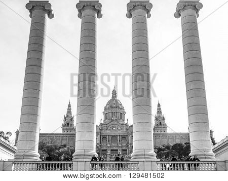 Barcelona Spain - February 21 2016: Winter day view of the columns representing the 4 bars of the catalan flag in Montjuich with the National Palace behind.