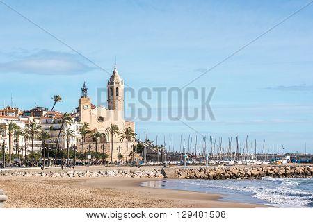 Views of the Sitges beach and the San Bartolome church