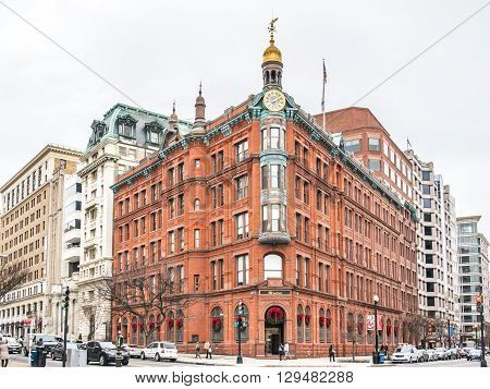 Washington D.C. - December 29 2014: The historic SunTrust building in Washington DC downtown. Build with red bricks and a gold dom tower with a clock.
