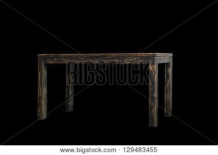 Empty wooden table isolated on black background
