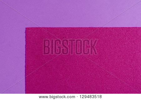 Eva foam ethylene vinyl acetate sponge plush pink surface on light purple smooth background