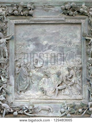 PISA, ITALY - JUNE 06, 2015: Jesus Christ enters Jerusalem, sculpture work from Giambologna's school, left portal panel of the Cathedral St. Mary of the Assumption in Pisa, Italy on June 06, 2015