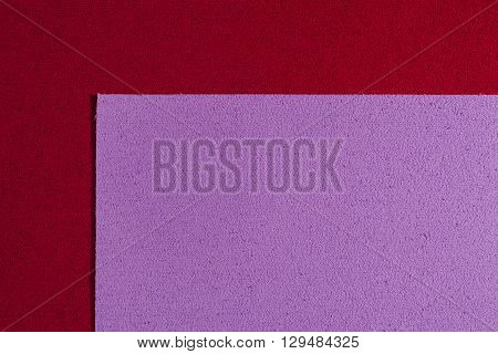 Eva foam ethylene vinyl acetate light purple surface on red sponge plush background
