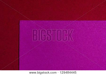 Eva foam ethylene vinyl acetate pink surface on red sponge plush background