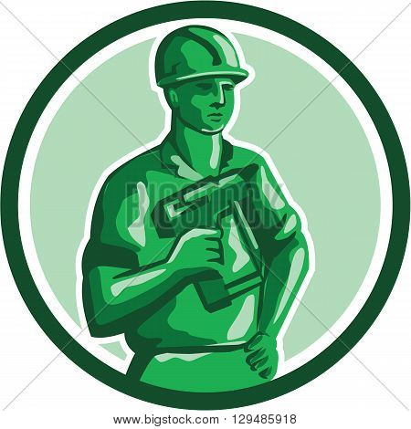 Illustration of a green plastic toy construction worker standing wearing hard hat holding nailgun and other hand on hips set inside circle on isolated background done in retro style.