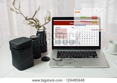 laptop with web design on photographer's desk