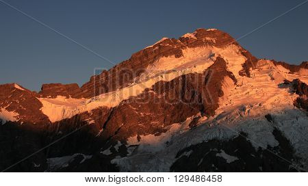 Mt Brunner at sunsise. High mountain covered by glacier. Morning scene near Mt Cook New Zealand.