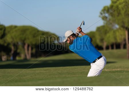 pro golf player shot ball from sand bunker at course