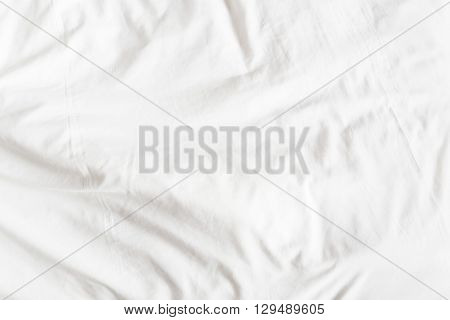Top view of a messy bedding sheet after night sleep and waking up in the morning.