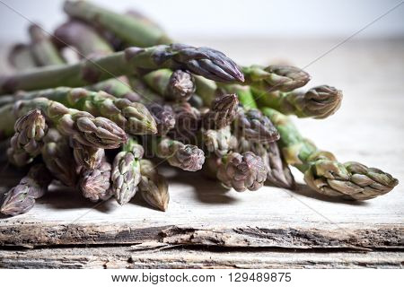 fresh asparagus closeup on rustic wooden table