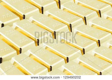 Stack of shiny gold bars / ingots in the central vault / storage room. National currency / treasury / gold reserved concept.